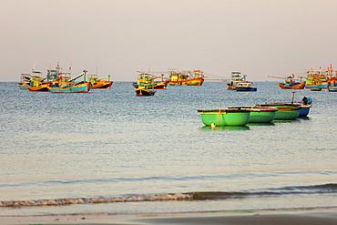 Colourful fishing boats moored in the water, Ke Ga Cape; Ke Ga, Vietnam