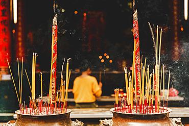 Worshiper at Thien Hau Temple; Ho Chi Minh City, Vietnam