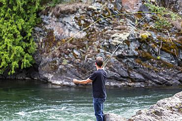 A man fly fishing on Adams River, near Salmon Arm; British Columbia, Canada