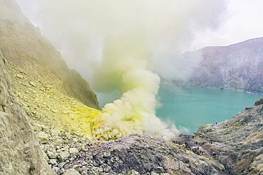 Sulphur smoke inside Ijen Volcano crater; East Java, Java, Indonesia