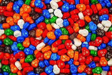 Colourful pile of skull candies in red, blue, orange, green, white, orange and brown; Studio