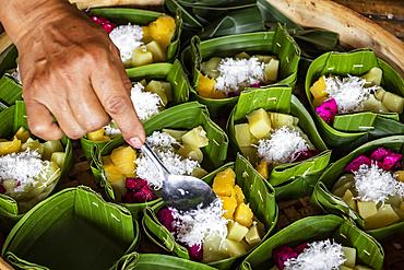 Fruit salad served in a banana leaf; Pedawa, Bali, Indonesia