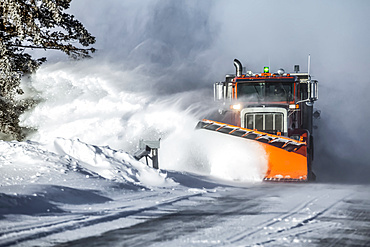Snow plow throwing fresh snow to the side of the road; Sault St. Marie, Michigan, United States of America