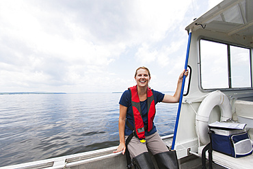 Public works engineer on service boat in reservoir