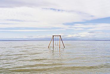 Artist installed swing set at Bombay Beach in the Salton Sea; Bombay Beach, California, United States of America
