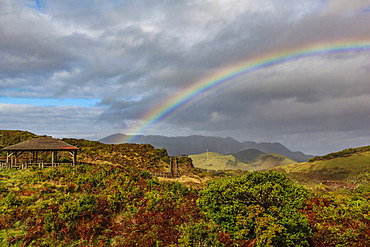 Rainbow crossing the mountainous landscape on the island of Terceira; Terceira, Azores, Portugal