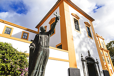 Statue of a religious figure holding a cross in front of the Main Church of Praia da Vitoria; Terceira, Azores