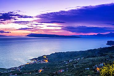 The stunning high altitude cliffside roads along the coastline of Croatia. A stop alongside the road to enjoy the sunset; Podgora, Splitsko-dalmatinska zupanija, Croatia