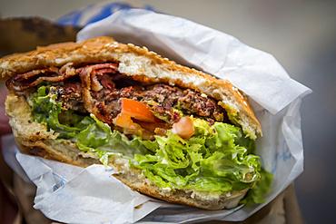 Close-up of Queenstown's most famous burger, the Ferburger; Queenstown, Otago, New Zealand