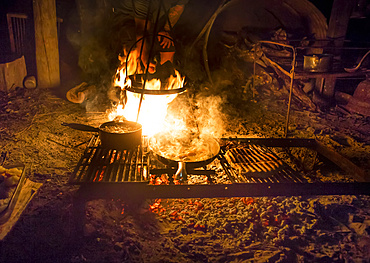 The Blue Duck lodge located in the Whanganui National Park is a working cattle farm with a focus on conservation. Fresh food is cooked over the campfire; Retaruke, Manawatu-Wanganui, New Zealand