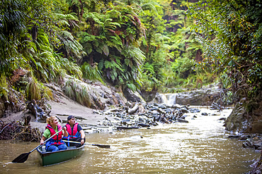 The Blue Duck lodge located in the Whanganui National Park is a working cattle farm with a focus on conservation. Kayaking down river through the beautiful rainforest; Retaruke, Manawatu-Wanganui, New Zealand