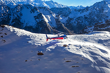 A helicopter tour provides stunning views over the Mt Cook glacier and surrounding mountaintops; Mount Cook National Park, Canterbury, New Zealand