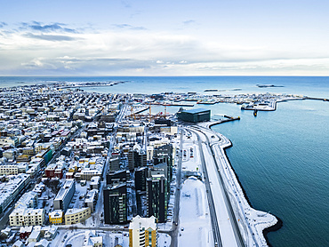 Views over the city centre of Reykjavik. The famed Harpa opera house sits on the edge of the ocean port; Reykjavik, Iceland