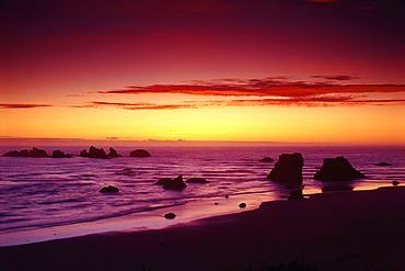 Sunset over Beach, Surf and Rock Formations, Bandon Beach, Oregon Coast, Oregon, USA