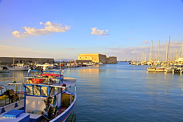 The boat lined Venetian Harbour and Fortress, Heraklion, Crete, Greek Islands, Greece, Europe