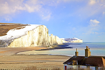Snow on The Seven Sisters and Coastguard Cottages, Seaford Head, South Downs National Park, East Sussex, England, United Kingdom, Europe