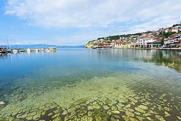 Ohrid old city reflected in the marina, Ohrid, UNESCO World Heritage Site, Macedonia, Europe