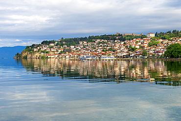 Ohrid old city reflected in Lake Ohrid, UNESCO World Heritage Site, Macedonia, Europe