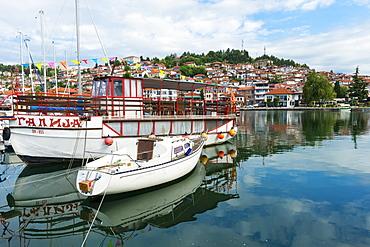 Boats reflecting on Ohrid Lake, Ohrid, UNESCO World Heritage Site, Macedonia, Europe