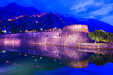 City ramparts at night in Kotor, Montenegro, Europe