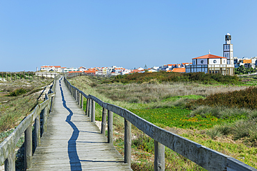 Wooden footpath at Costa Nova Beach, Costa Nova Church behind, Aveiro, Venice of Portugal, Beira Littoral, Portugal, Europe