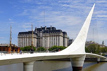 Women's rotating bridge, Puente de la Mujer, Ministry of Defence (Libertador) Building behind, Buenos Aires, Argentina, South America