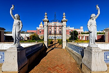 Statues framing the entrance of the Estoi Palace, Estoi, Loule, Faro district, Algarve, Portugal, Europe