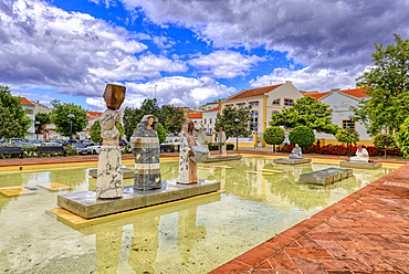 Square Al Muthamid with fountains and modern sculptures,Silves, Algarve, Portugal