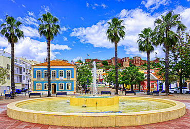 Fountain with a view of the Silves fortress, Algarve, Portugal