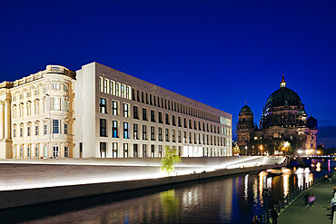 The Berlin Palace or Humboldt Forum along the Spree river, Berliner Dom illuminated at night, Unter den Linden, Berlin, Germany