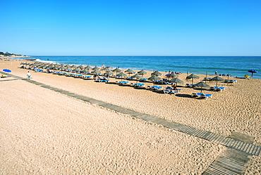 Umbrellas and beach chairs, Fisherman's Beach (Praia dos Barcos), Albufeira, Algarve, Portugal, Europe