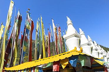 Stupas and flags at Shuzheng Tibetan village, Jiuzhaigou National Park, UNESCO World Heritage Site, Sichuan Province, China, Asia