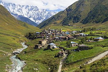 Traditional medieval Svanetian tower houses, Ushguli village, Shkhara Moutains behind, Svaneti region, Georgia, Caucasus, Asia