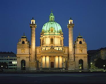 Austria, Vienna, Karlskirche illuminated at night