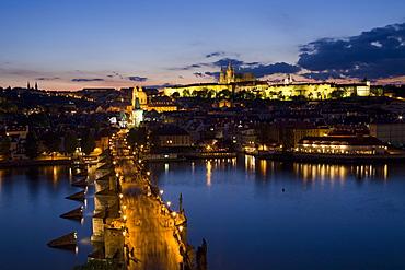 Charles Bridge over the River Vltava and Little Quarter illuminated at dusk, UNESCO World Heritage Site, Prague, Czech Republic, Europe