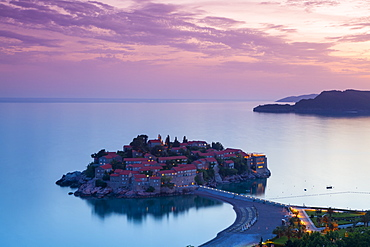 Elevated view over the picturesque island of Sveti Stephan illuminated at dusk, Sveti Stephan, Montenegro, Europe - 1158-448