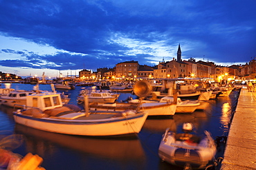 Ships and boats at the harbour and the old town with cathedral of St. Euphemia at dusk, Rovinj, Istria, Croatia, Adriatic, Europe