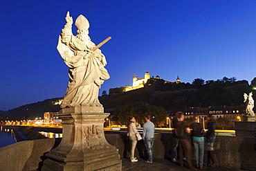 Figure of the St. Kilian, Baroque sculpture on the Old Bridge over Main River (Alte Mainbruecke), Marienberg Fortress, Wurzburg, Franconia, Bavaria, Germany, Europe