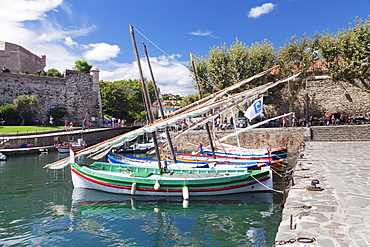 Traditional fishing boats at the port, Chateau Royal Fortress, Collioure, Pyrenees-Orientales, Languedoc-Roussillon, France, Europe