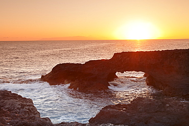 Rock arch at sunrise, Charco Manso Bay, Punta Norte near Echedo, UNESCO biosphere reserve, El Hierro, Canary Islands, Spain, Atlantic, Europe