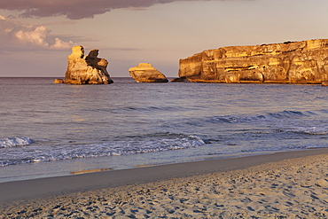 Rocky coast near Torre dell'Orso, Due Sorello Rocks (Two sisters) at sunset, Adriatic Sea, Lecce province, Salentine Peninsula, Puglia, Italy, Mediterranean, Europe