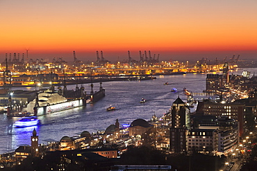 View over St. Pauli district and St. Pauli Landungsbruecken pier over the harbour at sunset, Hamburg, Hanseatic City, Germany, Europe