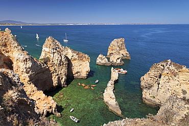 Excursion boats at Ponta da Piedade Cape, near Lagos, Algarve, Portugal, Europe