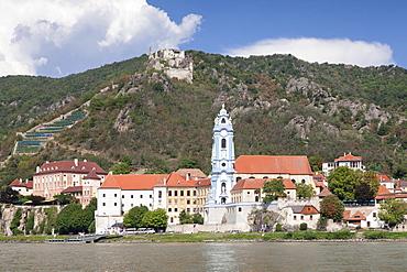 View over Danube River to Collegiate church and castle ruins, Durnstein, Wachau, Lower Austria, Europe