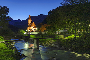Church by Ramsauer Ache river at night in Bavaria, Germany, Europe