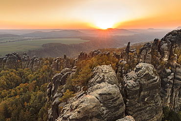 Schrammsteine rocks at sunset in Elbe Sandstone Mountains, Germany, Europe