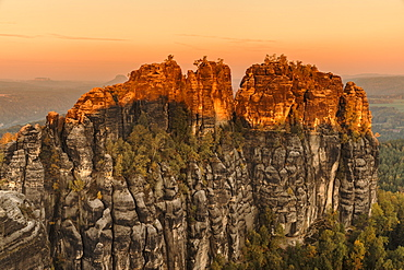 Schrammstein rocks at sunrise in Elbe Sandstone Mountains, Germany, Europe