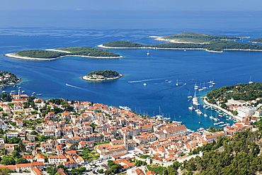 Elevated view of the old town and Pakleni Islands, Hvar Island, Dalmatia, Croatia, Europe