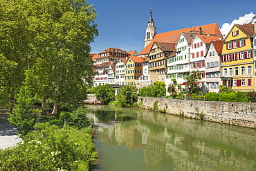 Old town with Stiftskirche church reflecting in Neckar river, Tubingen, Baden-Wurttemberg, Germany, Europe