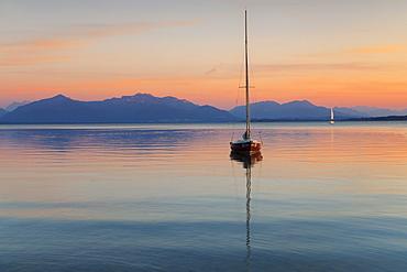 Sailing boat at sunset, Lake Chiemsee and Chiemgau Alps, Upper Bavaria, Germany, Europe